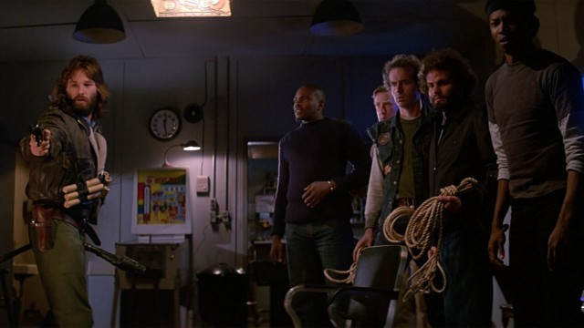 En fryktelig fiende truer disse personene i The Thing (Foto: Universal Pictures).